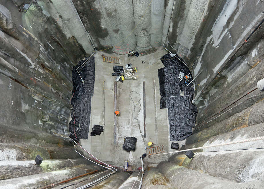 "Seattle Tunnel Partners has built a concrete ""cradle"" at the bottom of the pit dug to get at and repair Bertha, the tunneling machine. Photo: Washington State Department Of Transportation"