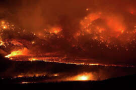 This image from Friday shows the fire burning in Mono County. The blaze has destroyed 40 homes in the towns of Swall Meadows and Paradise.