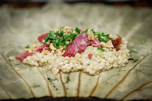 Brandon Jew's lotus leaf-wrapped sticky rice with Chinese sausage, peanuts, sweet sticky rice and chives is a reinvention of a dish his grandmother made.