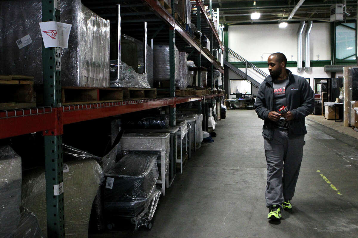 Logistics associate Rich Thurman checks inventory at Move Loot's 30,000-square-foot Dogpatch warehouse in S.F.