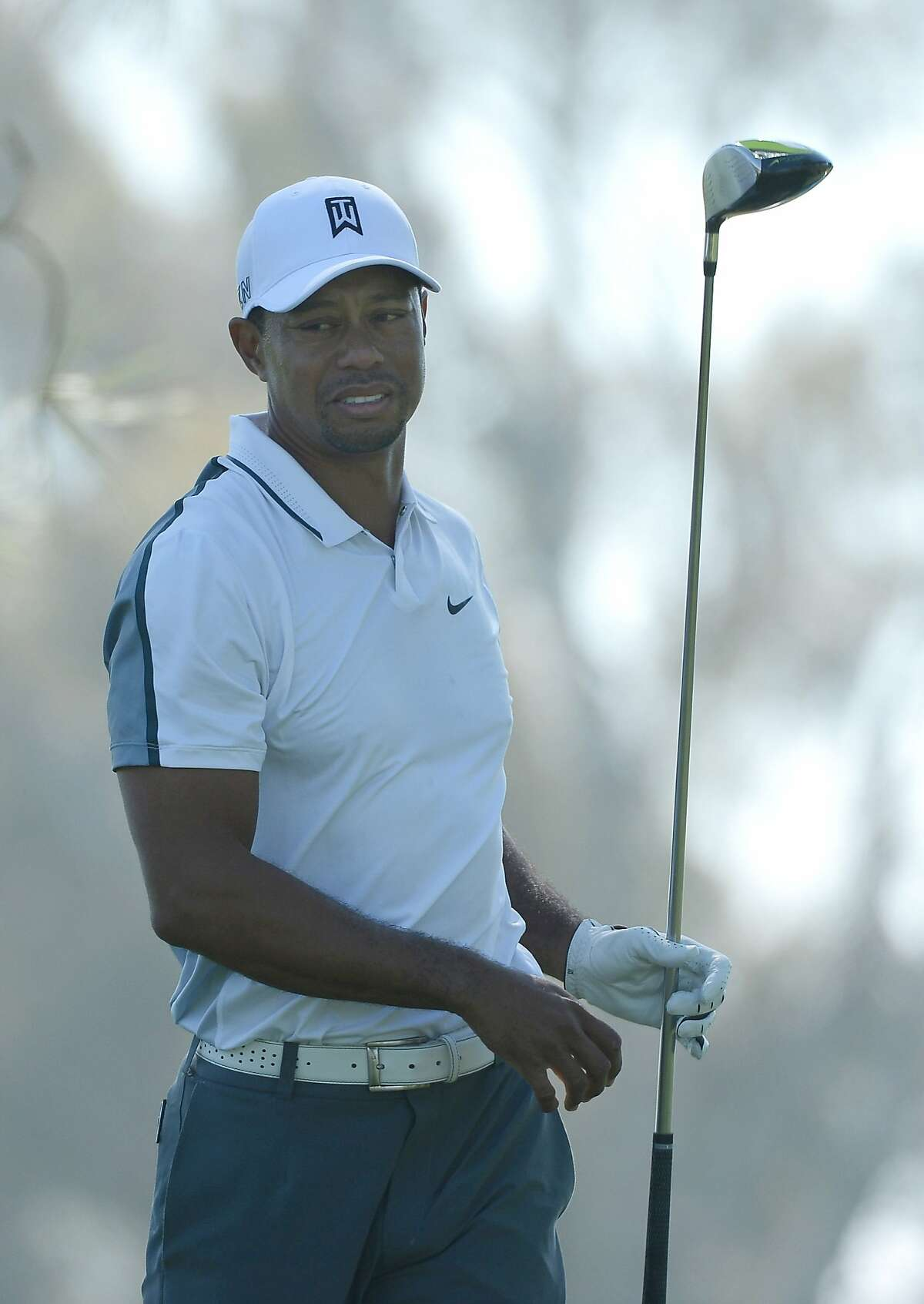 LA JOLLA, CA - FEBRUARY 05: Tiger Woods reacts after hitting his tee shot into the rough on the 11th hole of the north course during the first round of the Farmers Insurance Open at Torrey Pines Golf Course on February 5, 2015 in La Jolla, California. (Photo by Donald Miralle/Getty Images)
