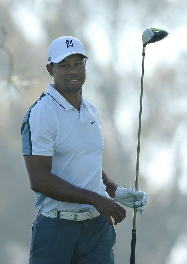 LA JOLLA, CA - FEBRUARY 05:  Tiger Woods reacts after hitting his tee shot into the rough on the 11th hole of the north course during the first round of the Farmers Insurance Open at Torrey Pines Golf Course on February 5, 2015 in La Jolla, California.  (Photo by Donald Miralle/Getty Images) Photo: Donald Miralle, Getty Images