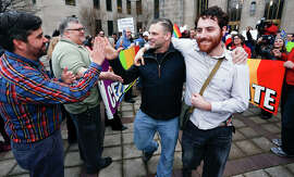 Supporters cheer newly married couple David Roby (center) and Erik Obermiller in Birmingham.