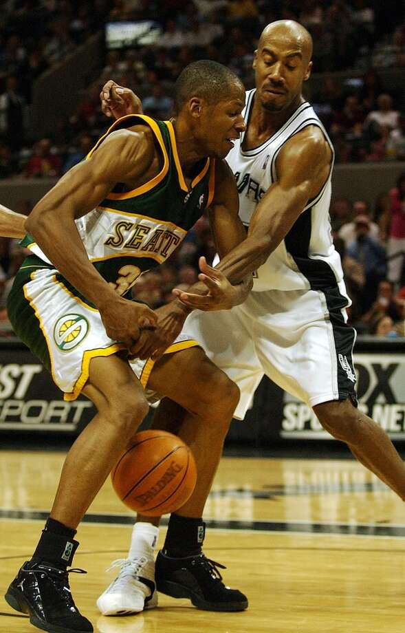 Spurs' Bruce Bowen (right) strips the ball from Seattle Supersonics' Ray Allen in the third quarter at the SBC Center on Wednesday, April 7, 2004. Spurs won 96-75. (Kin Man Hui/staff) Photo: SAN ANTONIO EXPRESS-NEWS