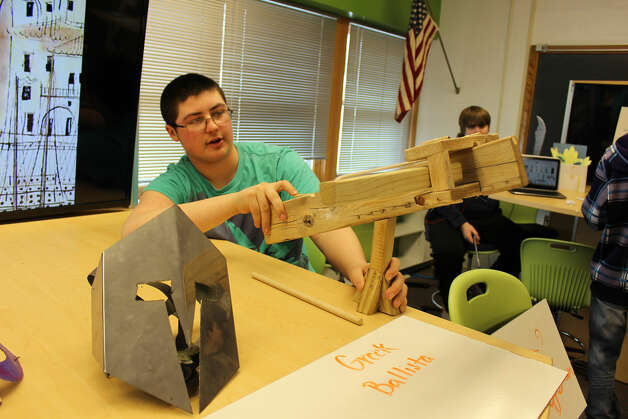 Damian Mabie of Canajoharie shows the Greek Ballista, or catapult, he made for PTECH's Greek Agora at the Jansen Avenue School in Johnstown on Friday.The HFM (Hamilton Fulton Montgomery) Pathways in Technology Early College High School students transformed their school halls and classrooms at the Jansen Avenue School into the ancient halls of the traditional Greek agora ? or market. (Submitted by Betsy DeMars)
