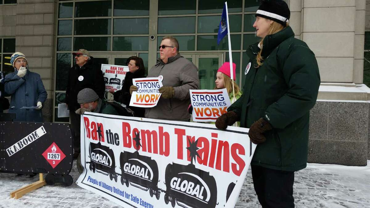 Opponnents of continued crude oil train shipments into the Port of Albany rally outside the downtown headquarters of the state Department of Environmental Conservation.