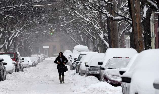 A pedestrian has no place to walk but the middle of Chestnut Street due to piled up snow from this storm and previous storms Monday afternoon Feb. 9, 2015 in Albany, N.Y.       (Skip Dickstein/Times Union) Photo: SKIP DICKSTEIN