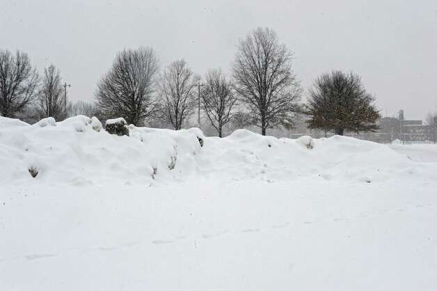 Large snowbanks are seen in Knickerbacker Park where the city of Troy dumps some of their extra snow on Monday, Feb. 9, 2015, in Troy, N.Y. (Lori Van Buren / Times Union) Photo: Lori Van Buren / 00030522B