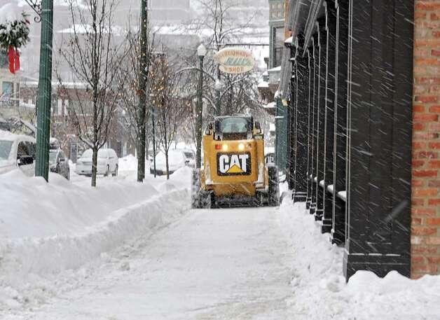 A snowplow clears the sidewalk during a snow storm on Monday, Feb. 9, 2015, in Troy, N.Y. (Lori Van Buren / Times Union) Photo: Lori Van Buren / 00030522A