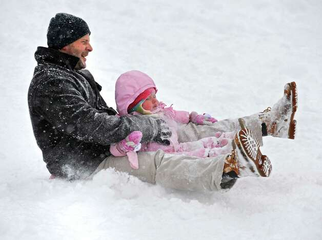 Frank Sawyer of Watervliet takes his 1 1/2-yr-old daughter Beige for a sleigh ride in Frear Park Monday, Feb. 9, 2015, during a snowstorm in Troy, N.Y. (Lori Van Buren / Times Union) Photo: Lori Van Buren / 00030522A
