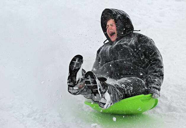 Alexandria McDonald of Troy takes a thrilling sled ride in Frear Park on Monday afternoon, Feb. 9, 2015, during a snowstorm in Troy, N.Y. (Lori Van Buren / Times Union) Photo: Lori Van Buren / 00030522A