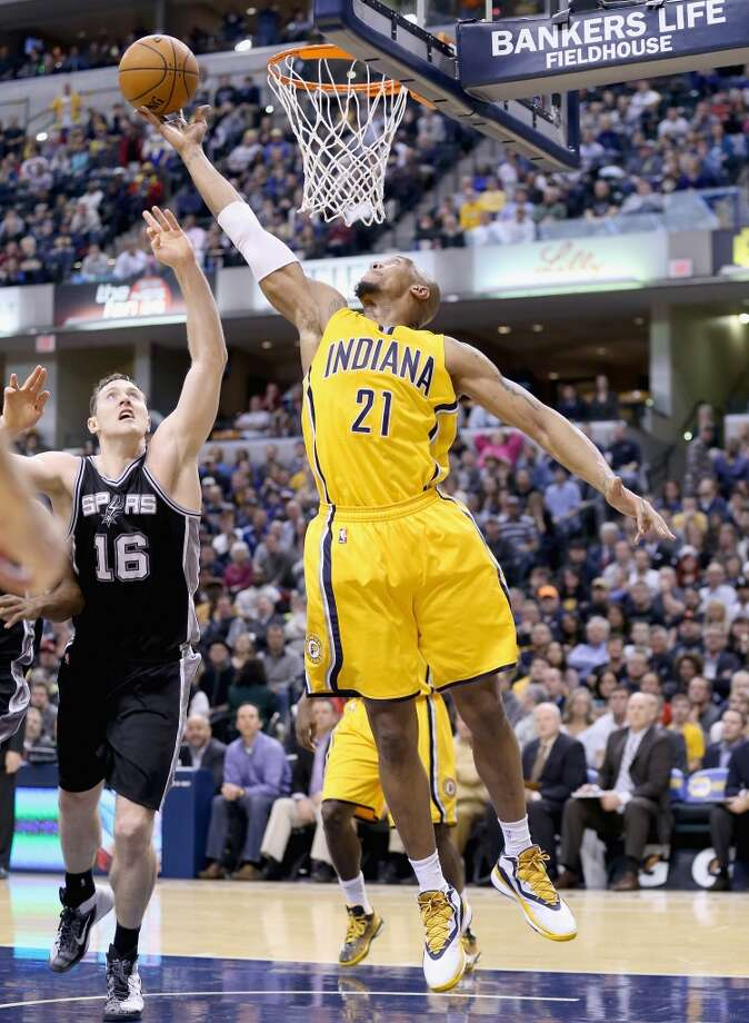David West #21 of the Indiana Pacers reaches for a rebound during the game against the San Antonio Spurs at Bankers Life Fieldhouse on February 9, 2015 in Indianapolis, Indiana. Photo: Andy Lyons, Getty Images