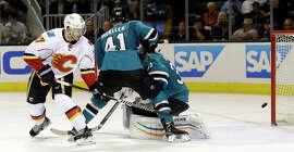 Lance Bouma knocks in a rebound despite the efforts of Sharks defenseman Mirco Mueller and goalie Antti Niemi.