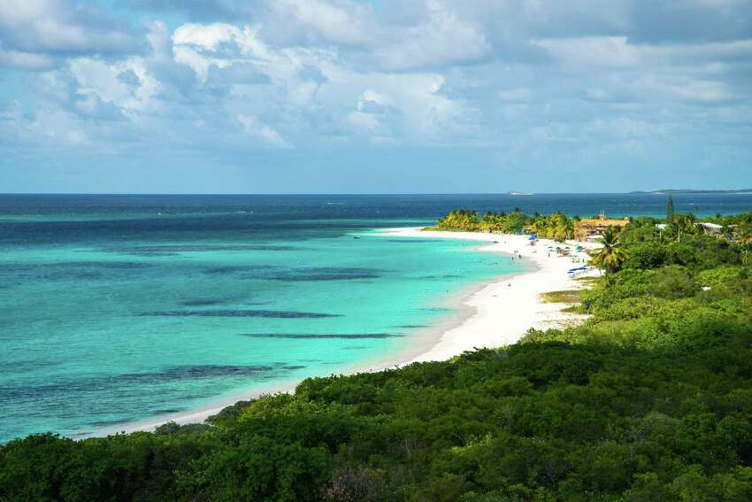 ANGUILLA Supine and scrubby, the island doesn't offer a lot of the usual volcanic, green Caribbean scenery, but its 30-some beaches are world-class beauties.