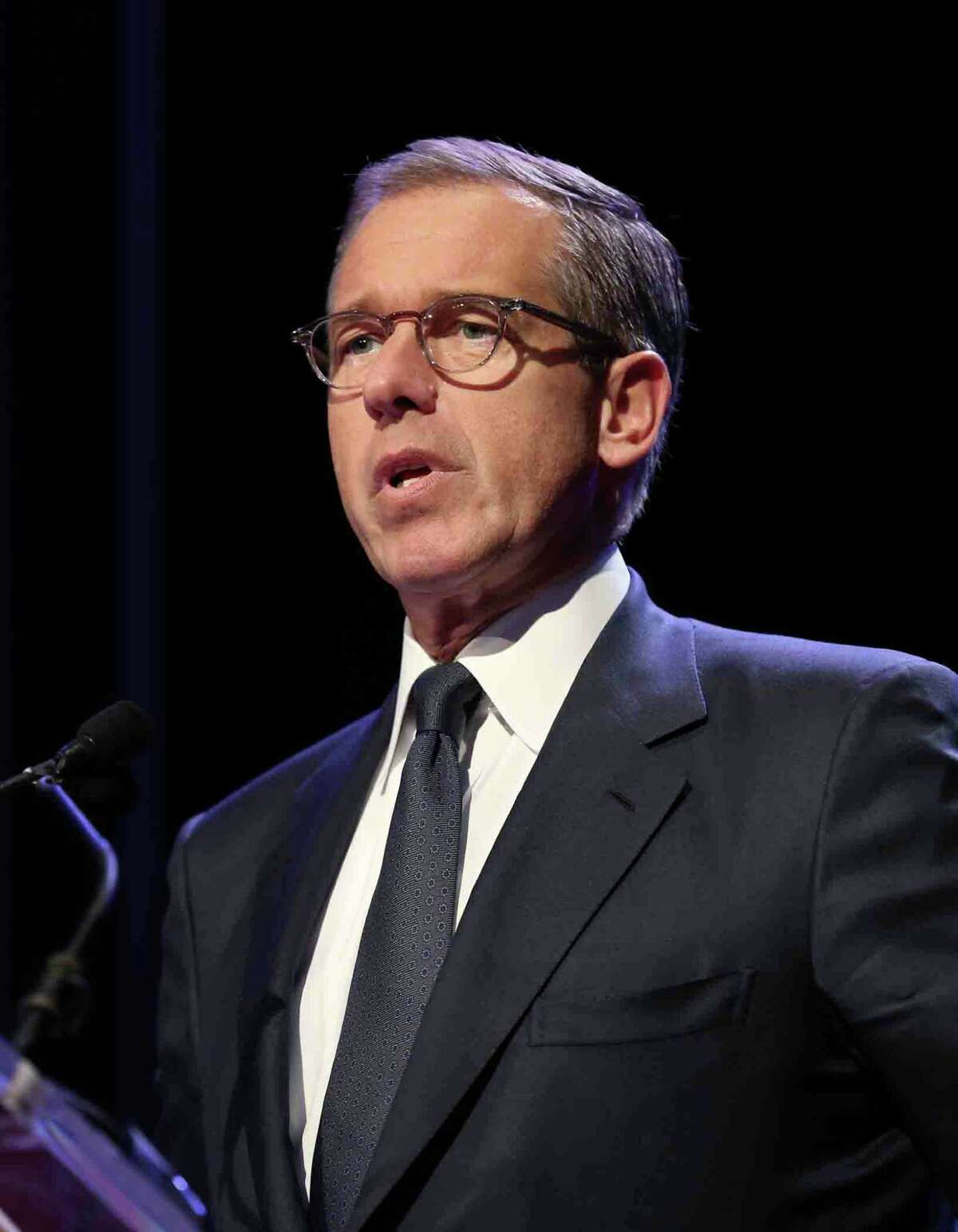 FILE - FEBRUARY 7, 2015: It was reported that NBC news anchorman Brian Williams is taking himself off the evening newscast temporarily as he is investigated over comments he made that misled the public February 7, 2015. NEW YORK, NY - MARCH 30: Emmy Award-winning anchor & managing editor of NBC Nightly News Brian Williams speaks at the 57th Annual New York Emmy awards at Marriott Marquis Times Square on March 30, 2014 in New York City.
