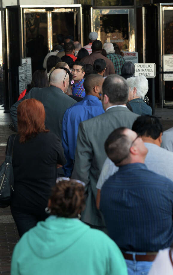 Jefferson County residents line the up to pass through security on Monday morning. A new online program is expected to help the County Clerk's office sift through potential jurors to reduce Monday's regular congestion.   Photo taken Monday, February 09, 2015  Guiseppe Barranco/The Enterprise Photo: Guiseppe Barranco, Photo Editor