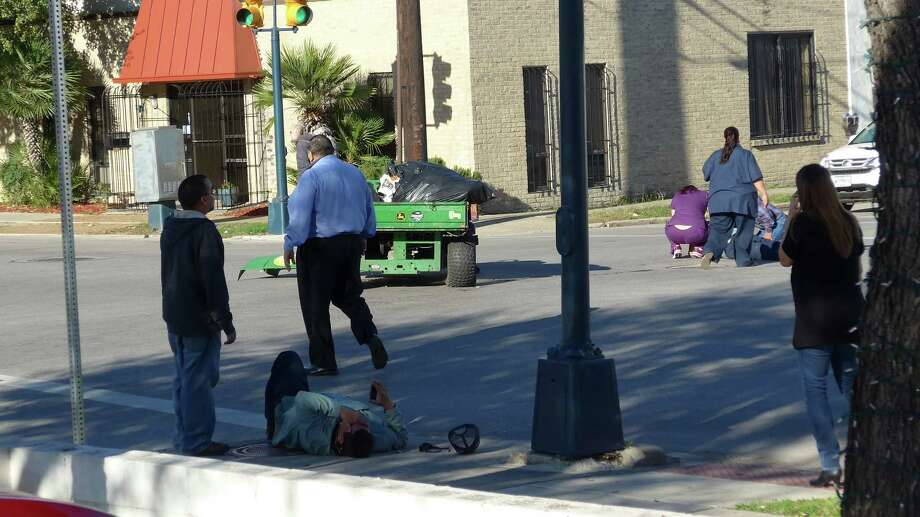 Two men were injured Tuesday morning after being hit by a truck while driving a small utility vehicle downtown. John W. Gonzalez/San Antonio Express-News Photo: San Antonio Express-News