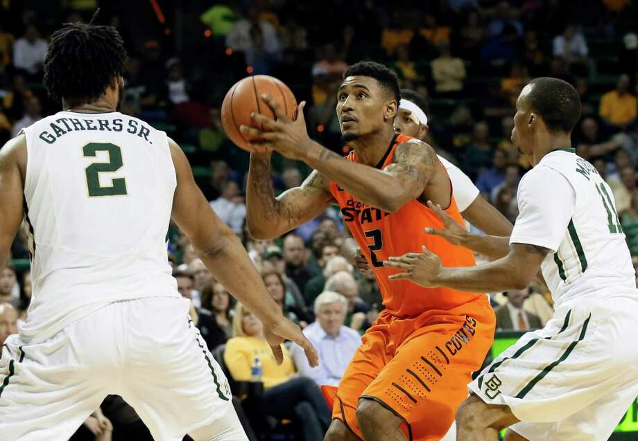 Baylor's Rico Gathers (2) and Lester Medford, right, defend as Oklahoma State guard Le'Bryan Nash (2) prepares shoot in the second half of an NCAA college basketball game Monday, Feb. 9, 2015, in Waco. Nash lead all scoring with 22-points in the 74-65 win over Baylor. Photo: Tony Gutierrez /Associated Press / AP