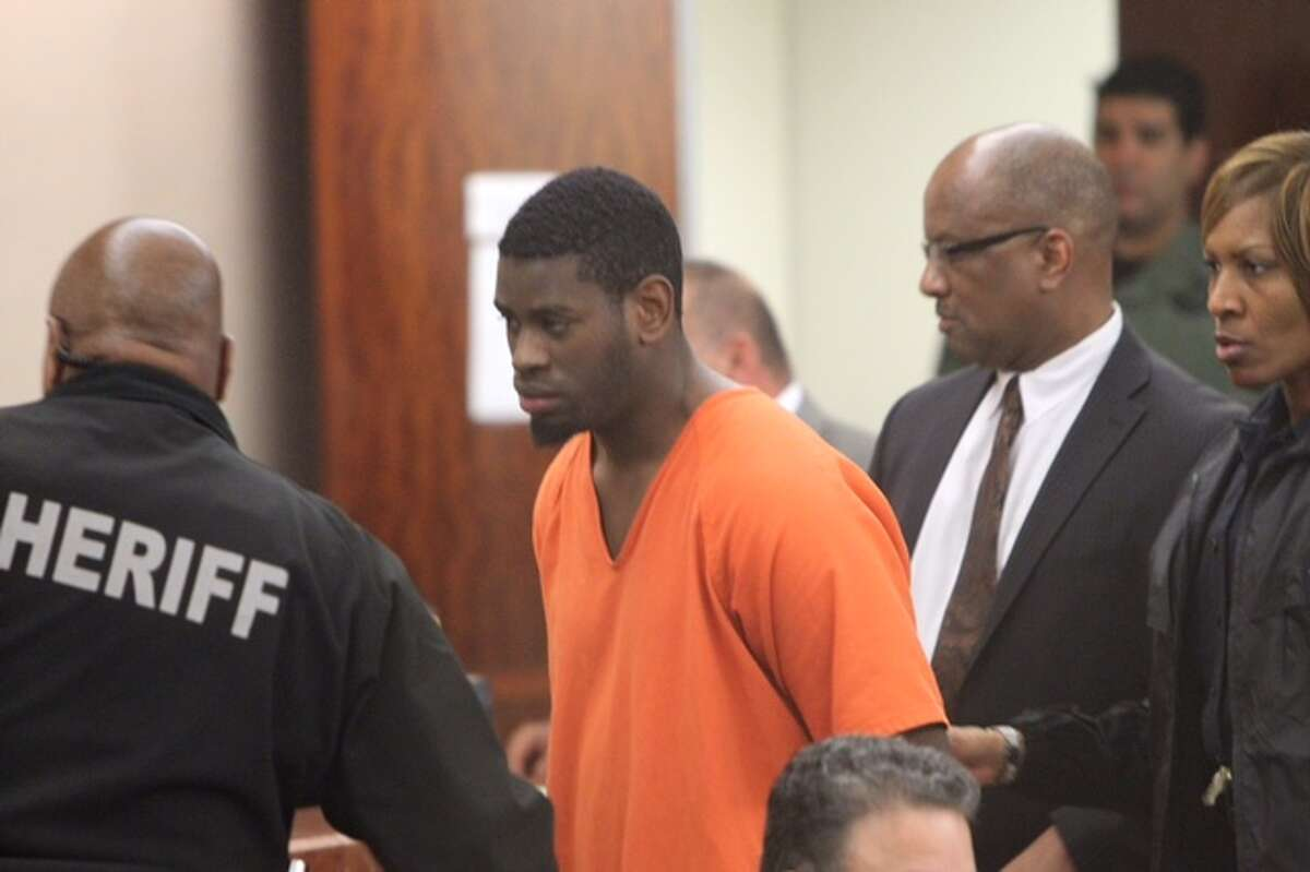 Isaac Tiharihondi is escorted into court Tuesday morning by Harris County sheriff's deputies.