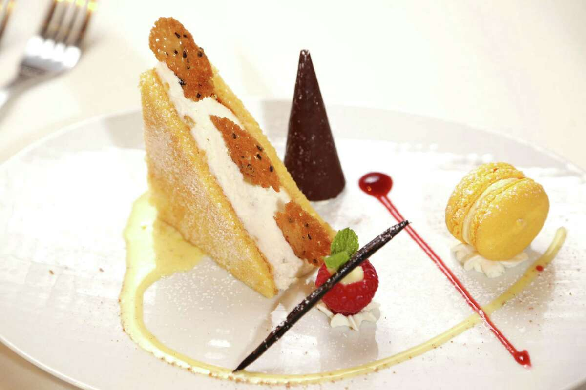 Torta Di Pere E Ricotta (ricotta cheese, caramelized pear mousse cake and an almond biscuit, drizzled with a vanilla bean cream sauce) at Amalfi