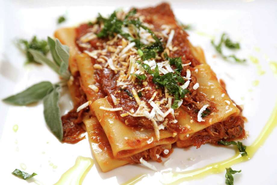 Amalfi Ristorante Italiano & Bar will participate in Houston's first Italian Restaurant Week, Nov. 14-20. Shown: Paccheri Al Ragu Di Maiale; paccheri pasta served with a ragu of braised Berkshire pork. Photo: Gary Coronado, Staff / © 2015 Houston Chronicle