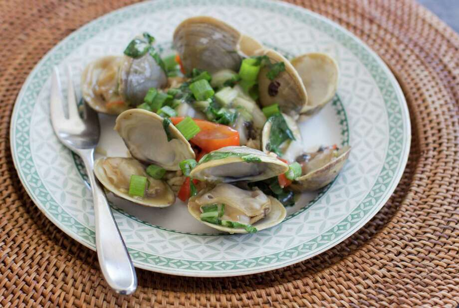 This Jan. 5, 2015, photo shows clams and bok choy with black bean sauce in Concord, N.H. Clams are lean and delicious source of protein and the automatic generator of a tasty, instant sauce. (AP Photo/Matthew Mead) Photo: Matthew Mead, FRE / FR170582 AP