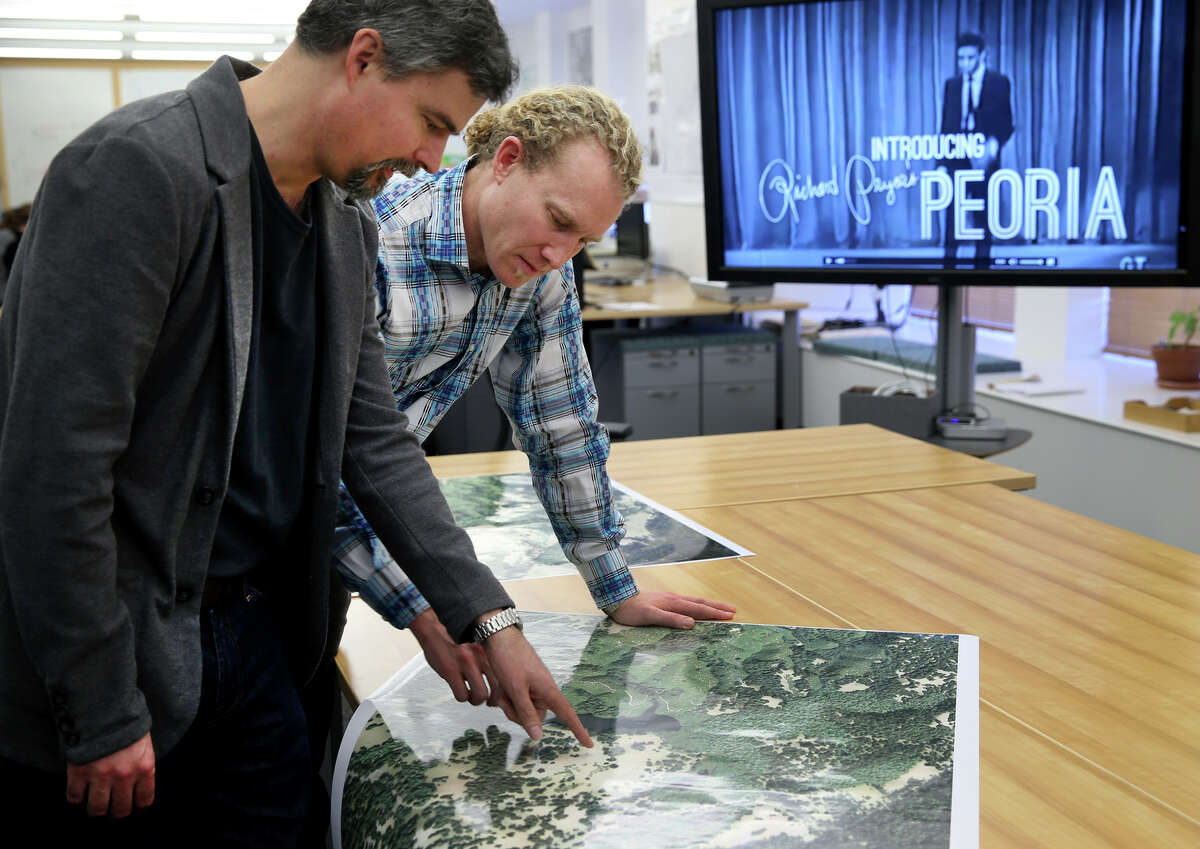 Zephyr Frank (left) and Erik Steiner view a large digital rendering of Jasper Ridge, located near the Stanford campus, at the Center for Spatial and Textual Analysis in Stanford, Calif. on Friday, Jan. 30, 2015. Stanford scholars at CESTA have developed a number of detailed interactive websites, including one on the early life of comedian Richard Pryor and another on Bay Area open space conservation, which is currently under development.
