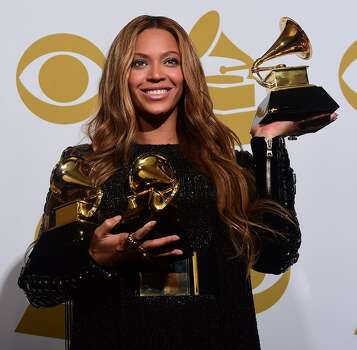 Beyonce  poses with her three Grammys for Best R&B Song and Best R&B Performance as well as for the more technical Best Surround Sound Album. Photo: FREDERIC J. BROWN, AFP / Getty Images