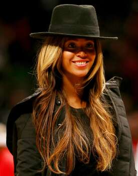 Beyonce walks off the court after the game between the Brooklyn Nets and the Houston Rockets at the Barclays Center on January 12, 2015. Photo: Elsa, Getty Images