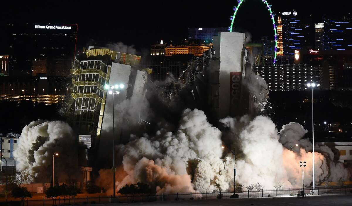 FLATTENED: The Clarion Hotel and Casino implodes in a cloud of dust during its demolition in Las Vegas. The 12-story Clarion, located just off the Las Vegas Strip, opened in 1970 as the Royal Inn and changed ownership over the years, becoming known by several names, including the Royal Americana Hotel, The Paddlewheel Hotel Casino, the Debbie Reynolds Hollywood Hotel and the Greek Isles Hotel & Casino. It closed for good in September 2014. The property was purchased for $22.5 million by Las Vegas developer Lorenzo Doumani, who plans to turn the six-acre property into a mixed-use resort.