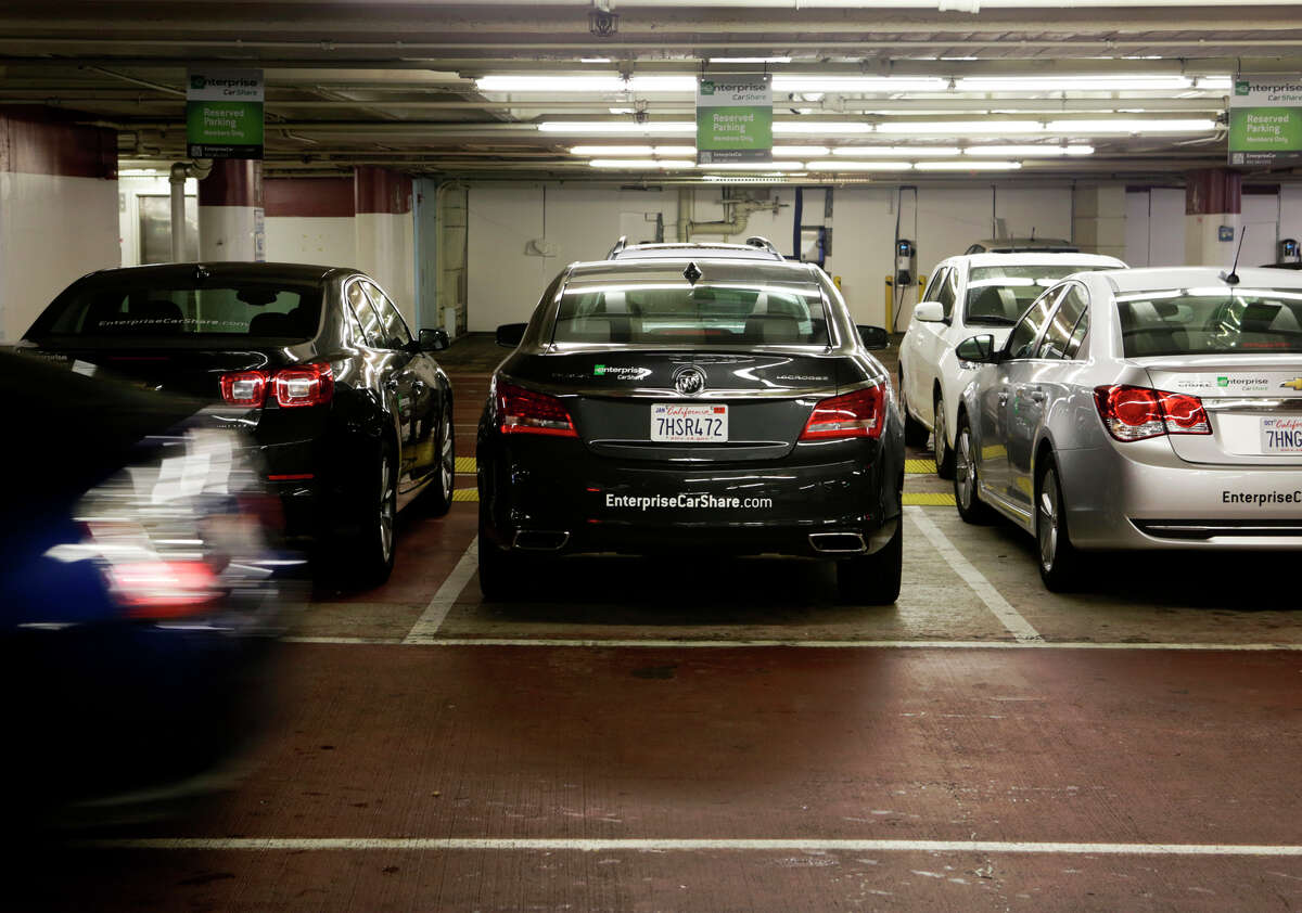 Enterprise CarShare vehicles are parked in the St. Mary's Square Garage in San Francisco. The service began operating last week in San Francisco, where there are a number of car-share companies to choose from.