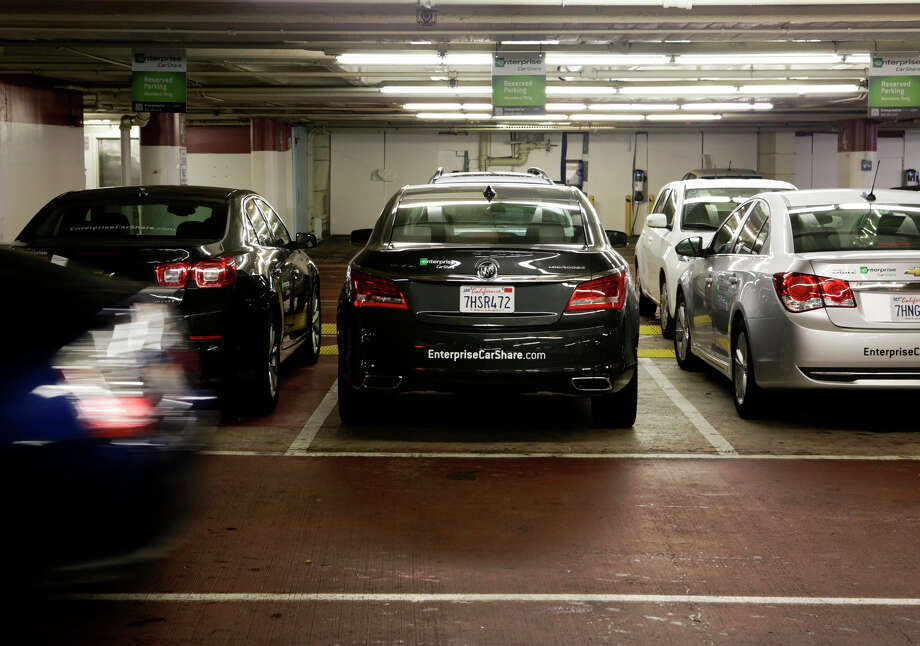 Enterprise CarShare vehicles are parked in the St. Mary's Square Garage in San Francisco. The service began operating last week in San Francisco, where there are a number of car-share companies to choose from. Photo: Terray Sylvester / The Chronicle / ONLINE_YES