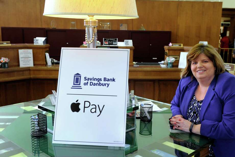 Kathleen Romagnano, president and CEO of the Savings Bank of Danbury on Main Street in Danbury, Conn., is photographed in the front lobby of the bank Tuesday, February 10, 2015. The bank is introducing ApplePay to its customers this week. Photo: Carol Kaliff / The News-Times