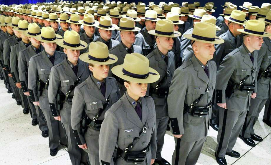 Nearly 230 new state troopers stand at attention during their graduation exercises in the Convention Center Tuesday, Feb. 10, 2015, at the Empire State Plaza in Albany, N.Y.  (John Carl D'Annibale / Times Union) Photo: John Carl D'Annibale / 00030444A
