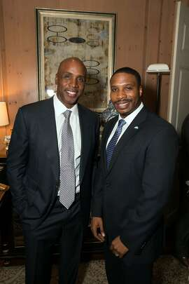 Former SF Giants slugger Barry Bonds (at left) with Guardsmen Sports Auction honoree Derick Brown at the Fairmont Hotel. Jan 2015. By Gustavo Fern‡ndez.