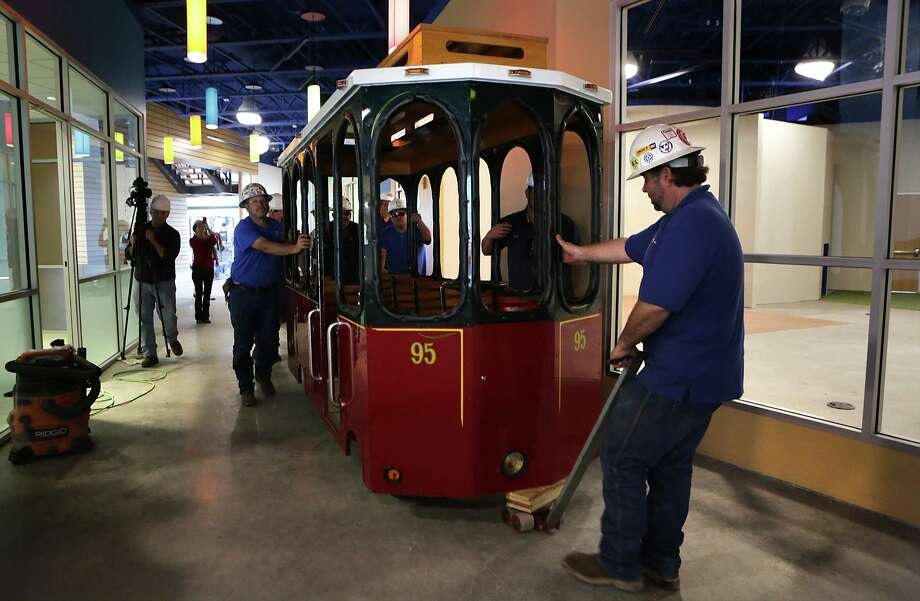 Movers guide Molly Trolley, the popular fixture at the San Antonio Children's Museum, as it is moved to it's new home at the still under construction DoSeum on Broadway.  Monday, Feb. 10, 2015. Photo: BOB OWEN, San Antonio Express-News / © 2015 San Antonio Express-News