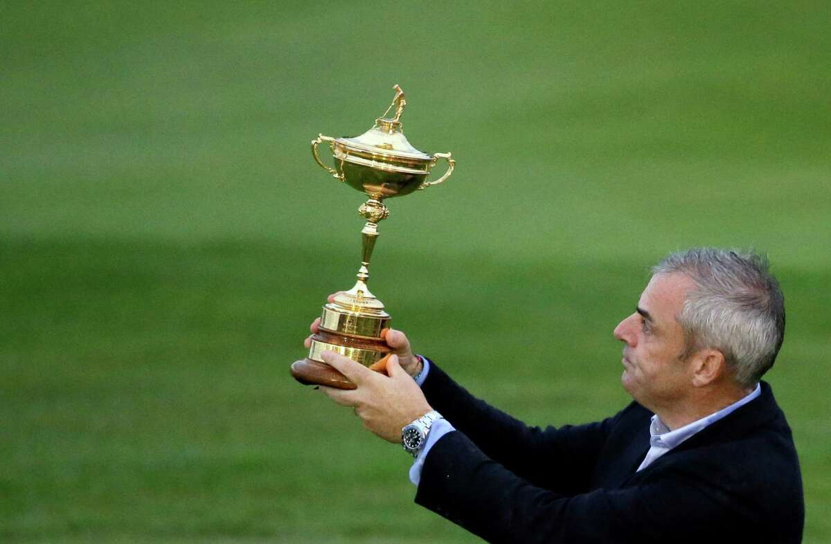 Team captain Paul McGinley holds up the Ryder Cup after Europe's victory in the 2014 Cup golf tournament in Gleneagles, Scotland.