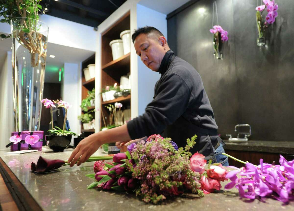 Floral designer Tony Montano creates a St. Valentine's Day Euro-Gathered arrangement at Winston Flowers on Greenwich Avenue, Greenwich, Conn., Thursday, Feb. 13, 2014. File Photo