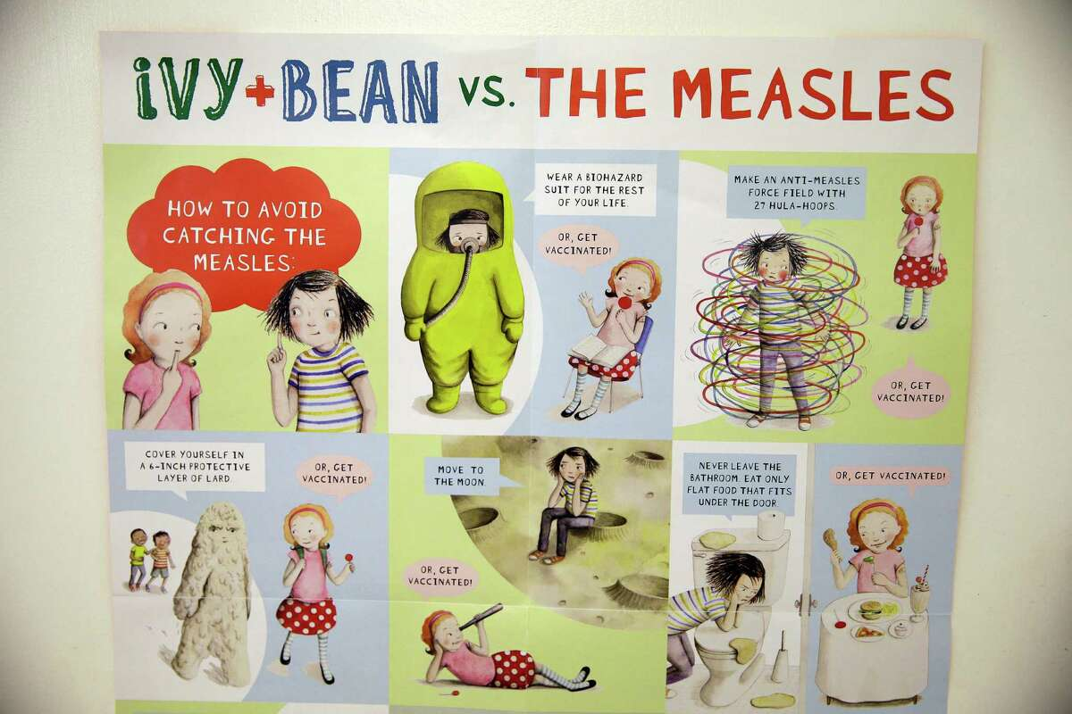 A poster educating parents and children about measles is displayed at the Tamalpais Pediatrics clinic Friday, Feb. 6, 2015, in Greenbrae, Calif. (AP Photo/Eric Risberg)