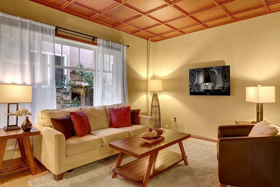 We'll start with the lowest priced home, 1107 E. Denny Way, No. A-5, which is listed for $167,500. The 510-square-foot condo has one bedroom, one bathroom, inlaid floors and a 10-foot box-beam ceiling. It's in the Lorington, which was built in 1909. Photo: Vista Estate Imaging, Courtesy Alex Eckardt/Coldwell Banker Danforth