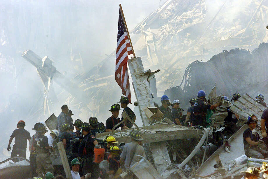 In this Sept. 13, 2001 file photo, an American flag flies over the rubble of the collapsed World Trade Center buildings in New York. Photo: Beth A. Keiser / Associated Press / AP