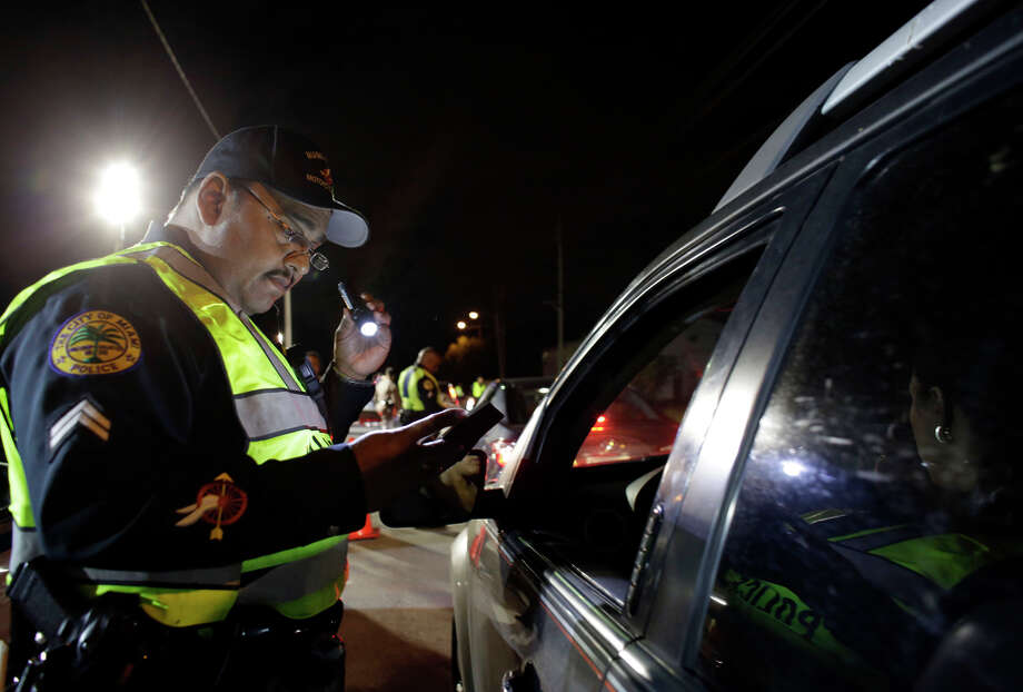 Drivers are required to give minimal cooperation at DUI checkpoints like this in Miami, according to an attorney. Photo: Lynne Sladky / Associated Press / AP