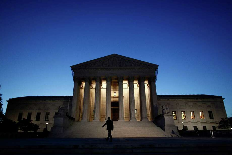 FILE -- The U. S. Supreme Court building in Washington, March 26, 2012. Questions and answers about a lawsuit before the court that has the potential to roll back a major portion of Obamacare: the subsidies that some 6 million middle-income people, across more than 30 states, now receive to buy health insurance. (Luke Sharrett/The New York Times) ORG XMIT: XNYT77 Photo: LUKE SHARRETT / NYTNS