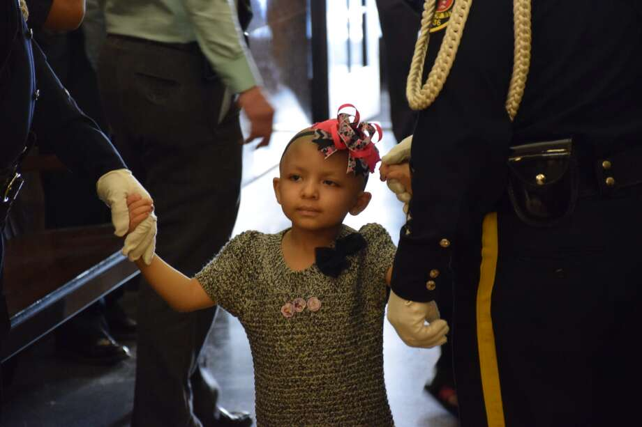Jalene Salinas, 4, was sworn in as an honorary Bexar County Sheriff's Deputy Tuesday. Salinas was diagnosed with a rare form of brain cancer in April of 2014. Photo: Mark D. Wilson/San Antonio Express-News