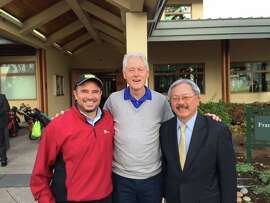 Former President Bill Clinton poses for a snapshot at San Francisco's Harding Golf Course with Mayor Ed Lee (right) and city Recreation and Parks general manager Phil Ginsburg.