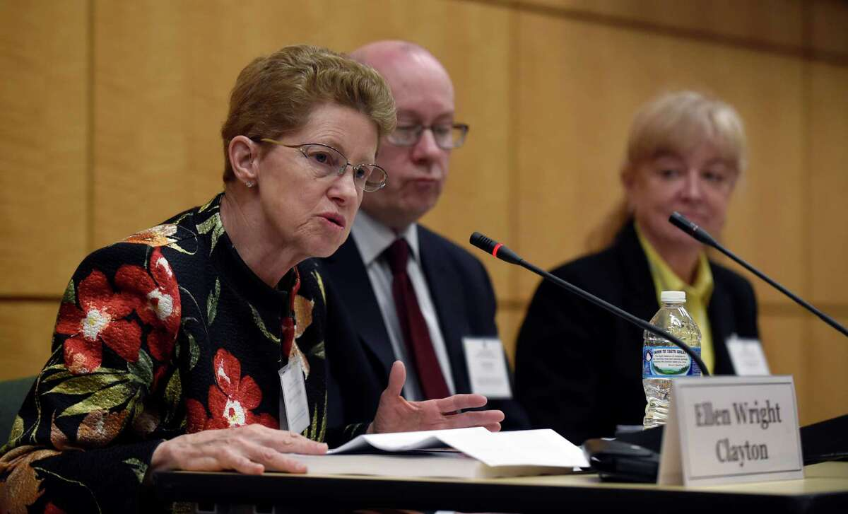 In Washington, panel chairwoman Dr. Ellen Wright Clayton details findings in the Institute of Medicine report while committee member Peter Rowe and Lucinda Bateman listen.