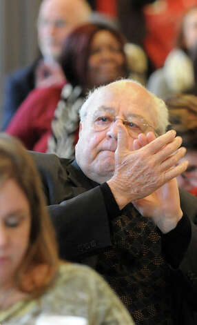 Father Peter Young, center, attends an event with the Friends of Recovery New York on Recovery Advocacy Day on Tuesday, Feb. 10, 2015, at Emmanuel Baptist Church in Albany, N.Y. (Cindy Schultz / Times Union) Photo: Cindy Schultz, Albany Times Union / 00030486A