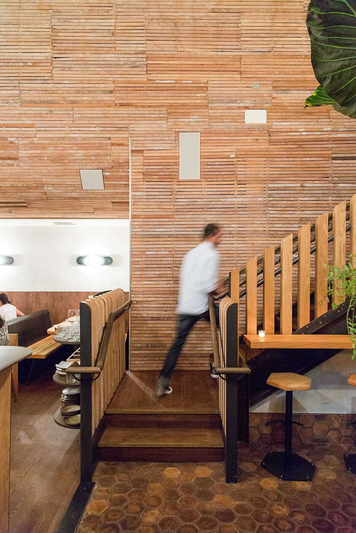 The original plaster was removed from the wood-slat walls exposing the architecture of the building at The Progress restaurant in San Francisco, Calif., Wednesday, February 4, 2015.