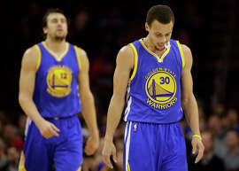 Andrew Bogut (left) and Stephen Curry look as though they're dragging in Monday's too-close-for-comfort win.