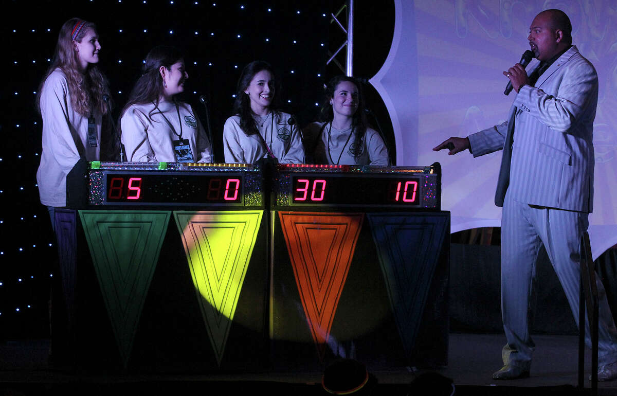 """Incarnate Word High School students (left to right) Alyssa Narendorf, Iliana Mallett, Sabrina Rivera and Shannon Gallagher play a TV-style game show Tuesday February 10, 2015 called """"Brain Cell"""" at the fourth annual Confluence summit held by the San Antonio Water System at the Henry B. Gonzalez Convention Center. This year's event focused on water quality and informed more than 800 students from public and private area high schools about the utility's water service. The game show host on the far right is Gus Davis."""